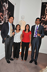 Left to right, DR VIJAY & SMITA PATEL and BHIKHU & SHASHI PATEL at the launch of the India Fantastique Exhibition and book launch featuring photographs by Ram Shergill and fashion by India's leading couturiers Abu Jani and Sandeep Khosla held at Sotheby's, 34-35 New Bond Street, London on 5th September 2012.