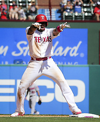 May 14, 2017 - Arlington, TX, USA - Texas Rangers shortstop Elvis Andrus (1) gestures to the dugout after hitting a double that scored Delino DeShields to tie the game against the Oakland Athletics in the seventh inning on Sunday, May 14, 2017 at Globe Life Park in Arlington, Texas. (Credit Image: © Richard W. Rodriguez/TNS via ZUMA Wire)