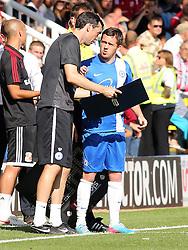 Peterborough United's Danny Swanson receives instructions from Peterborough United's first team coach Gary Breen - Photo mandatory by-line: Joe Dent/JMP - Tel: Mobile: 07966 386802 03/08/2013 - SPORT - FOOTBALL -  London Road Stadium - Peterborough -  Peterborough United v Swindon Town - Sky Bet One