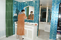 World  heavyweight champion boxer Mohammed Ali, known as the 'Greatest' seen in his bathroom at his Chicago home, USA in 1977. Also known as Cassius Clay. Photographed by Terry Fincher