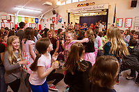 A dance party going on at Pleasant Street School after they received a surprise visit from Recycled Percussion on Friday morning.  (Karen Bobotas/for the Laconia Daily Sun)