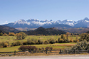 Harvested hay near Rocky Mountains in fall, Colorado<br />