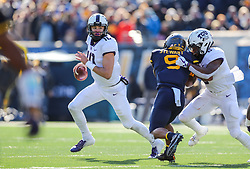 Nov 10, 2018; Morgantown, WV, USA; TCU Horned Frogs quarterback Michael Collins (10) rolls out of the pocket during the first quarter against the West Virginia Mountaineers at Mountaineer Field at Milan Puskar Stadium. Mandatory Credit: Ben Queen-USA TODAY Sports