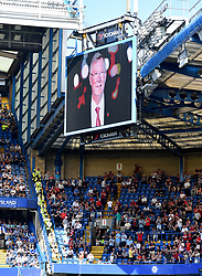 A tribute to Sir Alex Ferguson is displayed as the former Manchester United manager remains in intensive care during the Premier League match at Stamford Bridge, London.