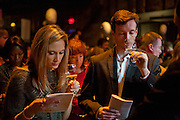A couple tasting and comparing notes at the New York Winter Wine Festival.