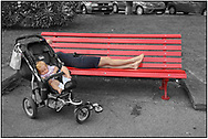 Day Tripper - Alpine Travels is a street photography series by photographer Paul Williams taken in 2008 taken at Montreau showing a mother and child asleep by the lake side. .<br /> <br /> Visit our REPORTAGE & STREET PEOPLE PHOTO ART PRINT COLLECTIONS for more wall art photos to browse https://funkystock.photoshelter.com/gallery-collection/People-Photo-art-Prints-by-Photographer-Paul-Williams/C0000g1LA1LacMD8