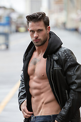 All American man without a shirt in a leather jacket
