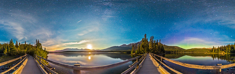 A 360° night panorama, lit by moonlight, taken from the boardwalk out to Pryamid Island on Pyramid Lake in Jasper National Park. Contructed in the 1930s, the Boardwalk takes you to a popular picnic spot, Pyramid Island at the north end of Pyramid Lake. The view across the water to the surrounding mountains is wonderful by day and by night. By night, this is a fabulous place for stargazing in this Dark Sky Preserve. <br /> <br /> Here, south is at left, toward Mt. Edith Cavell. To the southwest, the waxing gibbous Moon is setting. At right of centre, the Boardwalk leads to Pyramid Island itself, with Pyramid Mountain behind it. Right of the island is the Big Dipper. To the right of the image, to the northeast, there's a weak aurora display. The Milky Way is faintly visible in the moonlit sky overhead. <br /> <br /> This an 8-segement panorama, taken with the 15mm full-frame fisheye lens and Canon 6D. Each segment was a 32-second exposure at f/2.8 and ISO 1250, stitched with PTGui.