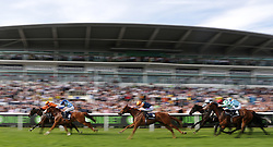 Shared Equity ridden by Jack Garritty (far left, orange cap) wins the Investec Zebra Handicap ahead of Swift Approval ridden by Oisin Murphy (no.8) during ladies day of the 2018 Investec Derby Festival at Epsom Downs Racecourse, Epsom.