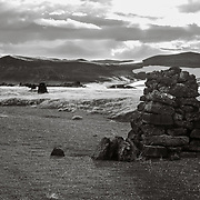 Cairn Line, Myvatn region. Cairn lines are seen around Iceland marking old routes across the barren landscape. In Icelandic the are called vörður meaning guardian, and they guided and protected travelers from trolls, ghosts, outlaws and huldufólk (hidden people). Some of these cairn lines date back to the 11th century.