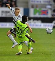 Tippeligaen Rosenborg - Haugesund 16 mai  2011<br /> Lerkendal Stadion, Trondheim<br /> <br /> Jonas Svensson, Rosenborg, og Umaru Bangura, Haugesund, i duell<br /> <br /> <br /> Foto : Arve Johnsen, Digitalsport
