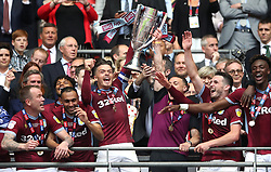 Aston Villa's Jack Grealish (centre) lifts the Sky Bet Championship Play-off Final Trophy with team-mates after the final whistle