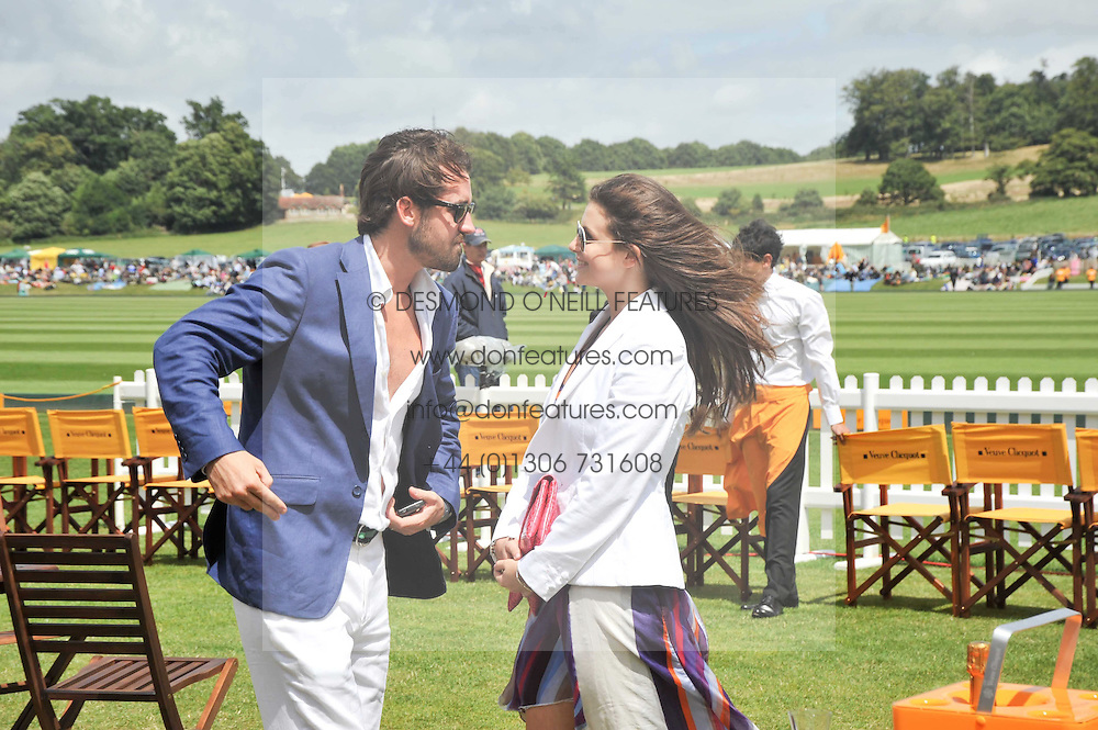 SHIRLEY LEIGH-WOOD OAKES and LOUIS BUCKWORTH at the 2009 Veuve Clicquot Gold Cup Polo final at Cowdray Park Polo Club, Midhurst, West Sussex on 19th July 2009.