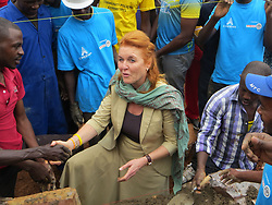 BEST QUALITY AVAILABLE The Duchess of York, Sarah Ferguson, helps to build a wall of a school during a visit to Kicukiro district in Kigali to see Rwandans take part in umuganda, which happens on the last Saturday of every month when people come together to carry out community work. The Duchess later attended the official opening of a new cricket stadium in the city.