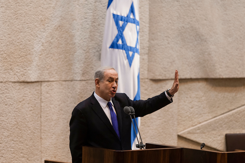 Israel's Prime Minister Benjamin Netanyahu gestures as he speaks during a special session marking the 37th anniversary of Entebbe Raid, at the Knesset, Israel's parliament in Jerusalem, on July 2, 2013. Operation Entebbe was a rescue mission performed by several Israel Defense Forces units in Uganda on July 4th 1976, for the liberation of 98 Jewish and Israeli hostages that were on board an Air France aircraft that was hijacked by Palestinian and German terrorists on June 27th, 1976. Operation Entebbe is sometimes referred to retroactively as 'Operation Jonathan' in memory of Yonatan Netanyahu, who was the older brother of Israel's Prime Minister Benjamin Netanyahu and the commander of the elite Israeli military unit sent for the mission. Yoni Netanyahu was the only Israeli soldier killed in the operation.