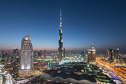 Burj Khalifa , the Dubai Mall and skyline of Downtown Dubai at night in United Arab Emirates
