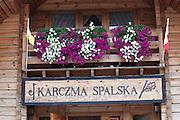 Flower window box above the entrance to the Karczma Spalska restaurant and inn. Spala Central Poland