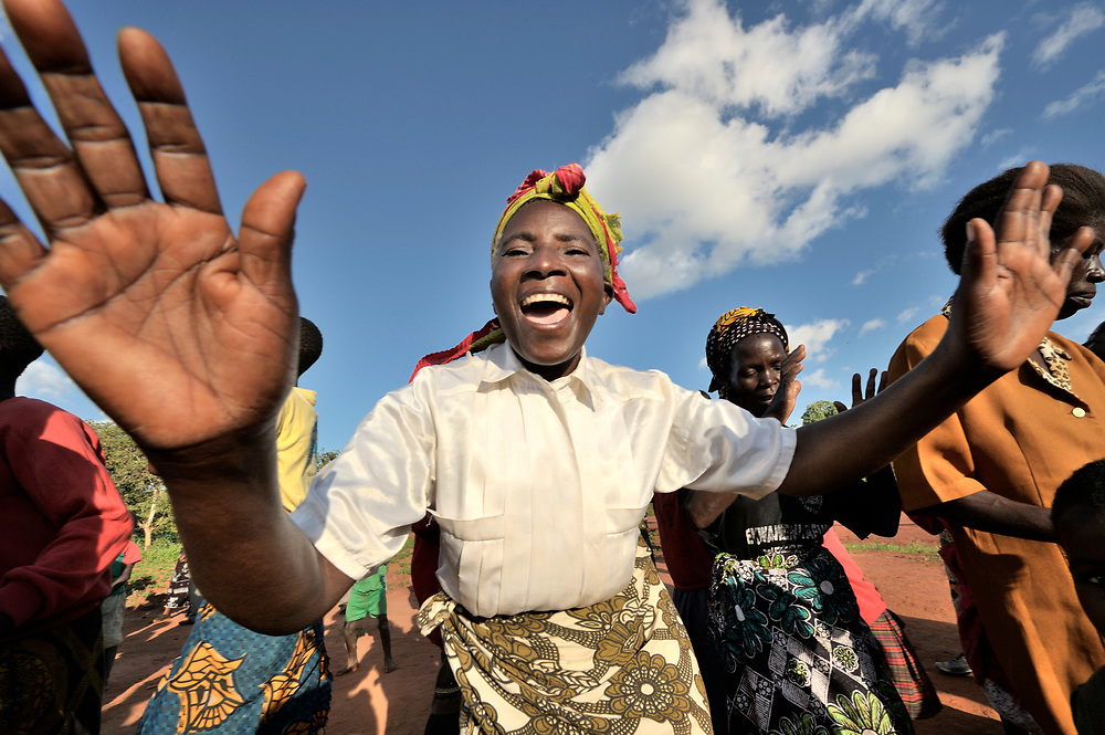 A woman dances as part of a celebration of the Presbyterian Church-sponsored Soils, Foods and Healthy Communities Project in Ekwaiweni, Malawi.