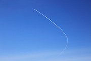 Contrail of airplane outlined in clear blue sky over Suffolk, England, UK