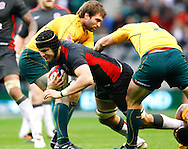 Tom Palmer of England is tackled by Stephen Moore (2) of Australia during the Investec series international between England and Australia at Twickenham, London, on Saturday 13th November 2010. (Photo by Andrew Tobin/SLIK images)