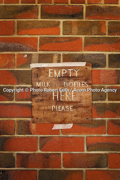 Empty milk bottle here please<br /> Makeshift sign at an old school