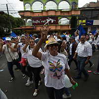 Supporters of National Party candidate Juan Orlando Hernandez shouted their slogan 'four years more' and made a four-finger-salute as they marched in front of a well-known centre of prostitution in Tegucigalpa. Videos circulated on social media shortly afterwards showing that many of those on the march had been paid 50 Lempiras to attend.