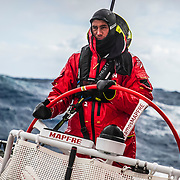 Leg 7 from Auckland to Itajai, day 10 on board MAPFRE, Blair To uke steering with massive cold and waves behind, 27 March, 2018.