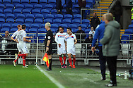 Wigan's goalscorer Jordi Gomez (r) celebrates with Nathan Byrne and his team mates after he scores his teams 1st and match winning goal. EFL Skybet championship match, Cardiff city v Wigan Athletic at the Cardiff city stadium in Cardiff, South Wales on Saturday 29th October 2016.<br /> pic by Carl Robertson, Andrew Orchard sports photography.