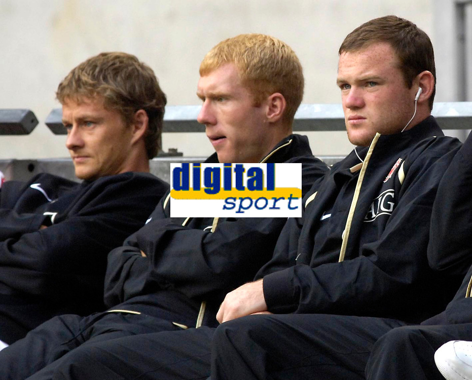 Photo: Daniel Hambury.<br />Ajax v Manchester United. Amsterdam Tournament. <br />05/08/2006.<br />Manchester's Paul Scholes, Wayne Rooney and Ole Gunnar Solskjaer sit on the bench before the game.