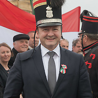 Istvan Simicsko (C) Hungary's Minister of Defence puts on a period hat during an event where people in period military uniforms re-enact a historic battle in Tapiobicske (about 60 kilometres East-Southeast of capital city Budapest), Hungary on April 4, 2018. ATTILA VOLGYI