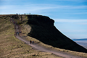 A group of adult and child ramblers walk along the dirt track along the summit of Pen Y Fan Mountain in Brecon Beacons National Park, Wales, Powys, United Kingdom. Pen Y Fan is the highest point in the Brecon Beacons hill and mountain range in South Wales. The National Park was established in 1957 due to the spectacular landscape which is rich in natural beauty.  (photo by Andrew Aitchison / In pictures via Getty Images)