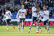 Bolton Wanderer's captain Jay Spearing is mobbed by teammates as they celebrate after scoring his sides third goal against Blackburn. Skybet championship match, Bolton Wanderers v Blackburn Rovers at the Reebok Stadium in Bolton, England on Saturday 1st March 2014.<br /> pic by David Richards, Andrew Orchard sports photography.