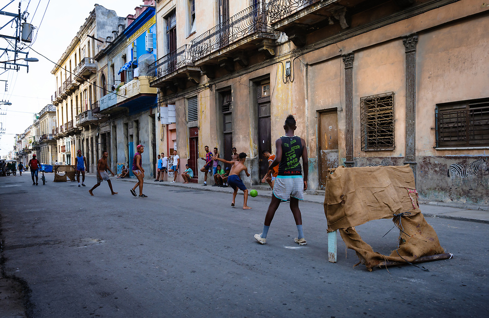 HAVANA, CUBA - CIRCA MAY 2017:  Boys playing soccer in the streets of  Havana. This is very typical around town.
