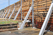"8/11/11} Vicksburg} -- Vicksburg, MS, U.S.A. -- Pictured is the levee in downtown Vicksburg already leaking, the city is try to shore up the leaks in hope of [reventing a major breach in hte levee which woulf flood downtown Vicksburg wWed. May 11,2011. Mark Bridges,56, thrift store owner, and his dog ""baby girl"" and his girlfriend of 12 years Patricia Clark, a homeDepot garden employee, cruise down Chicksaw Rd in a bass boat in North Kings Community in Vicksburg Mississippi Wed. May 5th 2011. This is the firs time for Patricia to try and remove things from her trailer, that is built on 9ft stilts  AND THE WATER IS CURRENTLY AT 15 ft. and rising and is less than 12 inches from being flooded. Mark and Patricia have lived their all their lives and will return when the Mississippi River recedes,. ark has been helping his neighbors get their belongings to safety. Vicksburg a riverfront town steeped in war and sacrifice, gets set to battle an age-old companion: the Mississippi River. The city that fell to Ulysses S. Grant and the Union Army after a painful siege in 1863 is marshalling a modern flood-control arsenal to keep the swollen Mississippi from overwhelming its defenses. PHOTO©SUZIALTMAN.COM.Photo by Suzi Altman, Freelance."