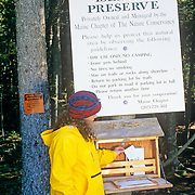 Hiker getting a map on the trail at the Great Wass Island preserve. Maine