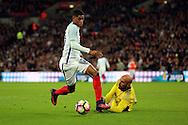 England striker Marcus Rashford (20) dribbling around Spain goalkeeper Pepe Reina (23) during the Friendly match between England and Spain at Wembley Stadium, London, England on 15 November 2016. Photo by Matthew Redman.