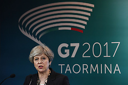 Prime Minister Theresa May speaks during a press conference at the G7 summit at Teatro Greco in Taormina, Sicily, Italy.