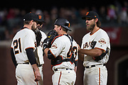 The San Francisco Giants talk at the mound during a game against the Colorado Rockies at AT&T Park in San Francisco, California, on April 14, 2017. (Stan Olszewski/Special to S.F. Examiner)