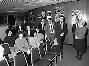 Presentation Of Donnelly Visas.  (R71)..1988..19.01.1988..01.19.1988..19th January 1988..As part of his interest in Ireland Congressman Brian Donnelly promoted a visa scheme to easily allow Irish people entry into America. Known now as the Donnelly Visas,Congressman Donnelly came to The American Embassy in Dublin to present the new visas to those where lucky enough in the first draw to obtain the visas...Image shows the recipients of the Donnelly Visas waiting for the official presentation in the American Embassy, as Congressman Donnelly arrives. Ambassador Heckler is also in the picture.