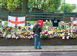 © London News Pictures. 25/05/2013. Woolwich, UK. Flowers at the scene where Drummer Lee Rigby was murdered by two men in Woolwich town centre in what is being described as a terrorist attack. Photo credit: Ben Cawthra/LNP