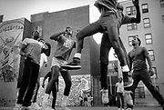 Hipshot, Houston St., NYC, where the camera on the ground is photographing the boys shooting baskets.