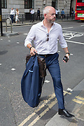 As heatwave temperatures climb to record levels - the hottest day of the year so far - a Londoner in the City of London the capitals financial district aka the Square Mile takes off his jacket on Threadneedle Street, on 25th July 2019, in London, England.