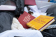 Discarded religious books in a skip on 12th June 2020 in Birmingham, United Kingdom. You can live forever in Paradise on Earth and Book of Bible Stories.