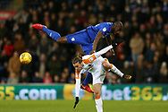 Sol Bamba of Cardiff city jumps over Jackson Irvine of Hull city. EFL Skybet championship match, Cardiff city v Hull city at the Cardiff city stadium in Cardiff, South Wales on Saturday 16th December 2017.<br /> pic by Andrew Orchard, Andrew Orchard sports photography.