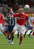 Photo: Paul Thomas.<br /> Nottingham Forest v Huddersfield. Coca Cola Championship.<br /> 06/08/2005.<br /> <br /> Chris Brandon and Ross Gardner.