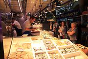 Inside mercado market fresh fish food stalls, La Latina, Madrid city centre, Spain