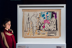 """© Licensed to London News Pictures. 21/01/2020. LONDON, UK. A staff member views """"In the studio"""", 1955, by Pablo Picasso at the preview of """"Picasso and Paper"""", an exhibition at the Royal Academy of Arts, which is the most comprehensive exhibition ever devoted to Pablo Picasso's imaginative and original uses of paper .  Over 300 works both on and with paper, are on display 25 January to 13 April 2020.  Photo credit: Stephen Chung/LNP"""