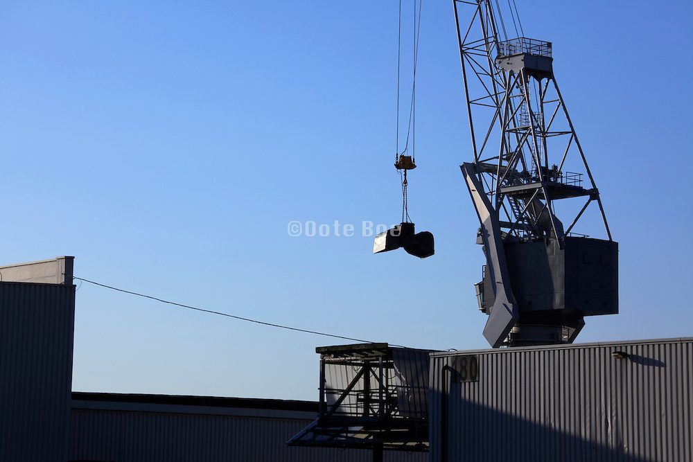 crane at rest in sea shipping port