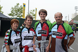 Family of Harlequins fans pose for a photo outside Twickenham Stadium.- Photo mandatory by-line: Alex James/JMP - 07966 386802 - 06/09/2014 - SPORT - RUGBY UNION - London, England - Twickenham Stadium - Saracens v Wasps - Aviva Premiership London Double Header.