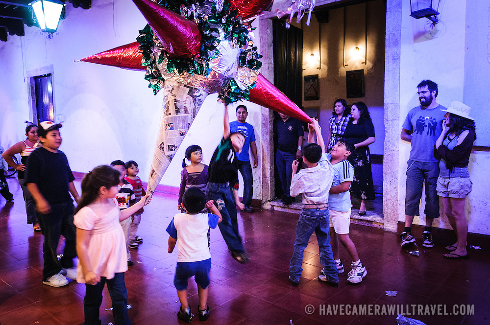 Children attack a pinata filled with sweets as party of the celebrations next to main square for the Queen of the Maya 2011 Festival in downtown Valladolid, a colonial town in the heart of Mexico's Yucatan Peninsula.
